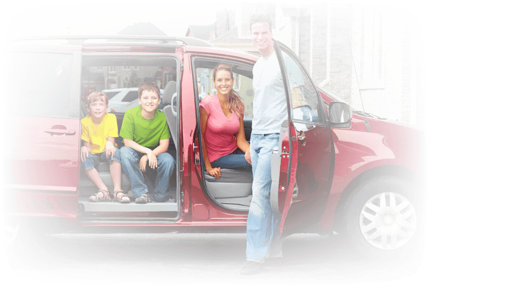 Happy family in their car after Brake Services performed