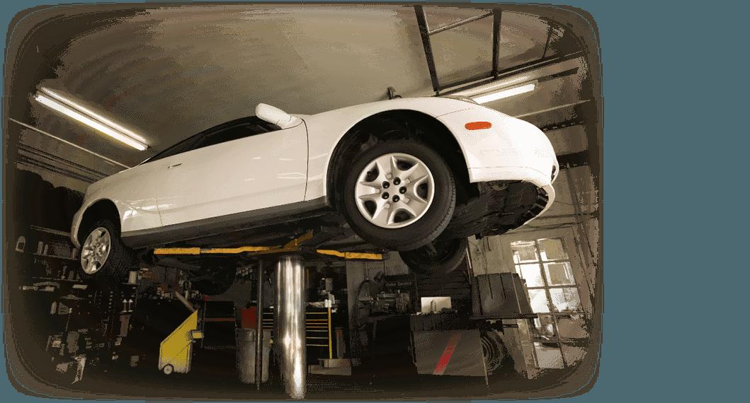 Car raised on a car lift in preparation for Auto Repair