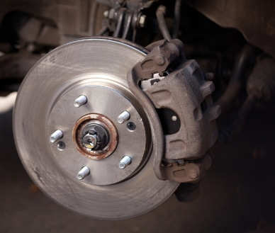 Showing old brake rotor during brake repair