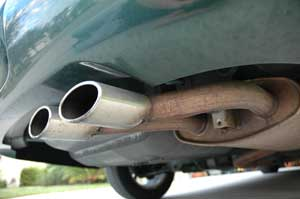 Exhaust tips and muffler under a car